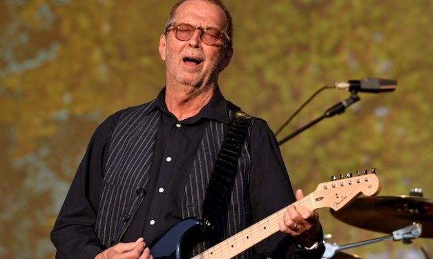 CLAPTON LOOMS LARGE IN RARE APPEARANCE